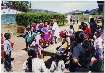 Photograph of women from the Jelly Group and Bobbe Seibert cleaning a work station after making jelly in Honduras in 2000.