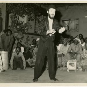 "Photograph of Thomas Hebert performing in ""The Gossip of Ewa"" with his students at Ahmadiyya Grammar School in Nigeria."