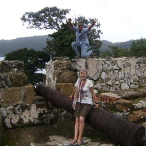 Photograph of Rachel Teter and a friend posing near a cannon at one of the fortifications on the Caribbean side of Panama (Portobelo-San Lorenzo) in Colón, Panama. 26 December 2011.