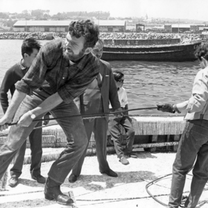 Photograph of Peace Corps Volunteer Peter Wadsworth pulling in fishing nets with his fellow cooperative members in 1967.
