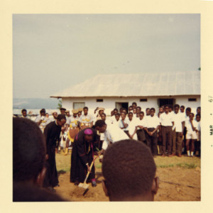 Photograph of the Bishop of Masaka planting a tree during the dedication of the new wing of St. Henry's College, February 1967.