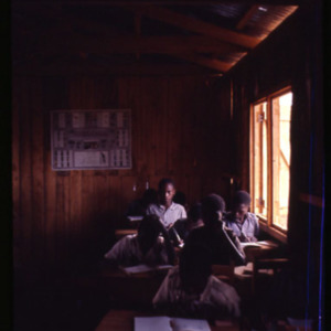 Photograph of boys seated at desks in a classroom at the Chinga school in Kenya, May 1967.
