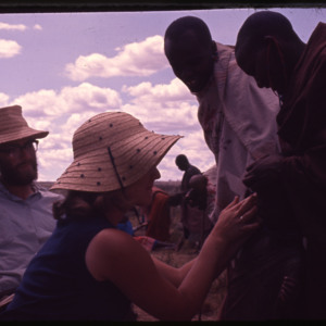 Photograph of a woman assisting with the Maasai Medical Project in Kenya in 1966.
